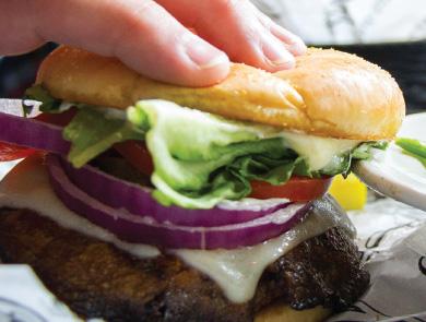 Hand picking up a burger